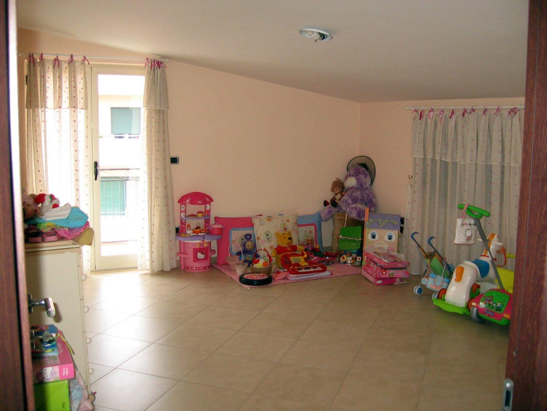 Progetto di arredo di una cameretta per bambini for Progettare la cameretta